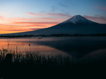 Silhouette style from 25s to 35s man sit and wait for see sunris. E from kawaguchi lake and fuji mountain background from japan Royalty Free Stock Photography