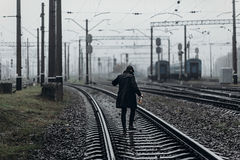Silhouette of stylish man in retro look walking in rain on backg Stock Images