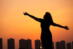 Silhouette success woman hands up Stock Photos