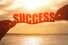 Silhouette of success word. Silhouette of hand take family success with sunset Royalty Free Stock Photo