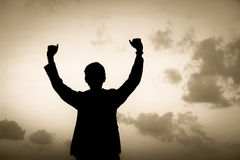 Silhouette successful. Businessman hand fist gesture Royalty Free Stock Image