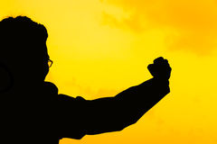 Silhouette successful. Businessman hand fist gesture Royalty Free Stock Photography