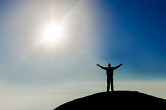 Silhouette of successful man on the mountain peak Royalty Free Stock Images