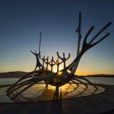 Silhouette of the Sun Voyager Sólfar sculpture at sunrise. By Jón Gunnar Árnason, in Reykjavík, Iceland Stock Photo