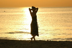 Silhouette at sunset. Woman silhouette Royalty Free Stock Photography