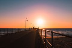Long Jetty to Sunset Royalty Free Stock Image