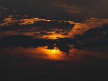 Silhouette of sunset behind the cloud Stock Images
