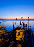 Silhouette sunset of fishing boat. Royalty Free Stock Image