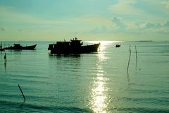 Silhouette sunset fishing boat on it´s prepare to fishing royalty free stock image