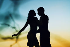 Silhouette at sunset lovers Stock Image