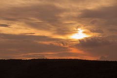 Silhouette of sunset over dark black mountain royalty free stock images