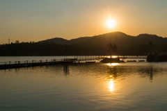 silhouette, sunset over the lake and mountain Royalty Free Stock Photography