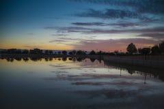 Silhouette Sunset reflection Stock Photo