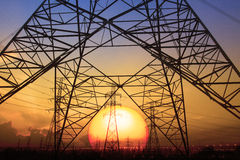 Silhouette sunset scene of high voltage electrical pole structur Royalty Free Stock Photo