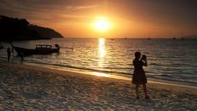 Silhouette sunset seascape at Lipe, Satun. Silhouette tourist woman take seascape sunset of Andaman tropical sea in Koh Lipe, Satun, Thailand. Summer holiday stock photography