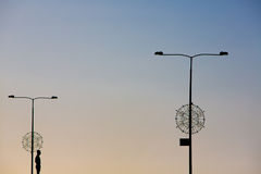 Silhouette, sunset and urban street light Stock Photography