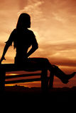 Silhouette sunset woman sitting Stock Photos