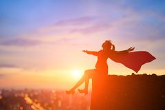 Super business woman on mountain royalty free stock photo