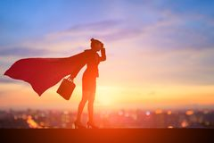 Silhouette of super business woman royalty free stock photography