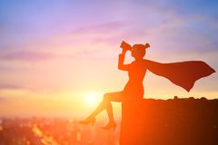 Silhouette of super business woman stock photos