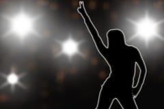 Silhouette super star on  stage under flash gun Stock Photo