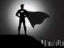 Silhouette superhero in the city Royalty Free Stock Photo