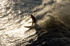 Silhouette of a surfer Stock Photos