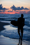 Silhouette of surfer on beach in sunset Royalty Free Stock Image