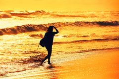 Silhouette of the surfer girl Royalty Free Stock Photo