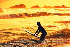Silhouette of the surfer girl Stock Photo