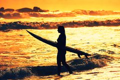 Silhouette of the surfer girl Stock Photos