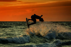 Silhouette of surfer at sunset Royalty Free Stock Photography