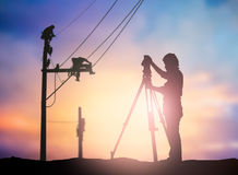 Silhouette survey engineer working  in a building site over Blur Royalty Free Stock Photos