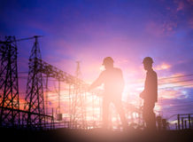 Silhouette survey engineer working  in a building site over Blur Stock Image