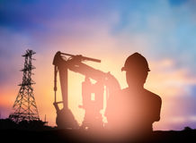 Silhouette survey engineer working  in a building site over Blur Stock Images