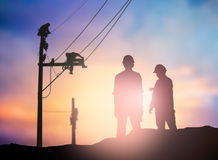 Silhouette survey engineer working  in a building site over Blur Royalty Free Stock Photography