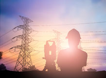 Silhouette survey engineer working  in a building site over Blur Royalty Free Stock Image
