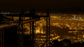 Silhouette of the suspension railway and Barcelona panoramic nig Stock Photo
