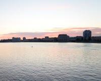 Silhouette of the Sverdlovskaya embankment before dawn. Royalty Free Stock Photo