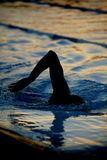 Silhouette swimmer 03. A silhouette of a swimmer swimming laps at dusk Stock Photos