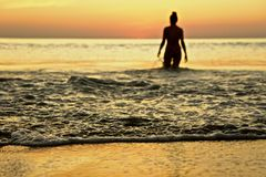 Silhouette of swimmer in water Stock Photo