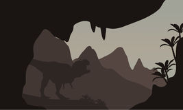 Silhouette of T-Rex in highlands Stock Image
