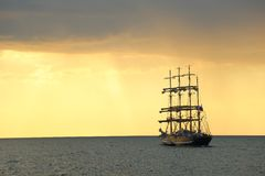 Silhouette of the tall ship at sunset Royalty Free Stock Photography