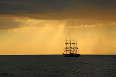 Silhouette of the tall ship at sunset Stock Photography