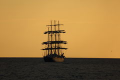 Silhouette of the tall ship at sunset Royalty Free Stock Photo