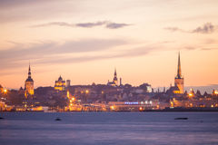 Silhouette of tallinn with fire sunset Stock Photos