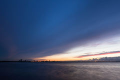 Silhouette of tallinn with sea sunset Stock Image