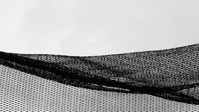 Silhouette of fishing net - monochrome. Silhouette of tangle fishing net - background monochrome stock photography