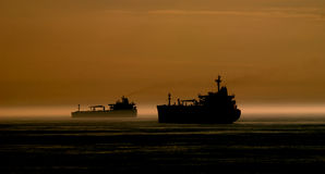 Silhouette tanker at anchor at sunset Royalty Free Stock Photos