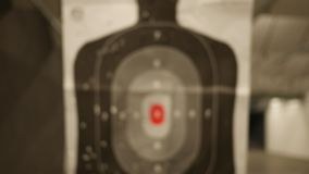 A silhouette target at a gun range slides towards the camera - normal version